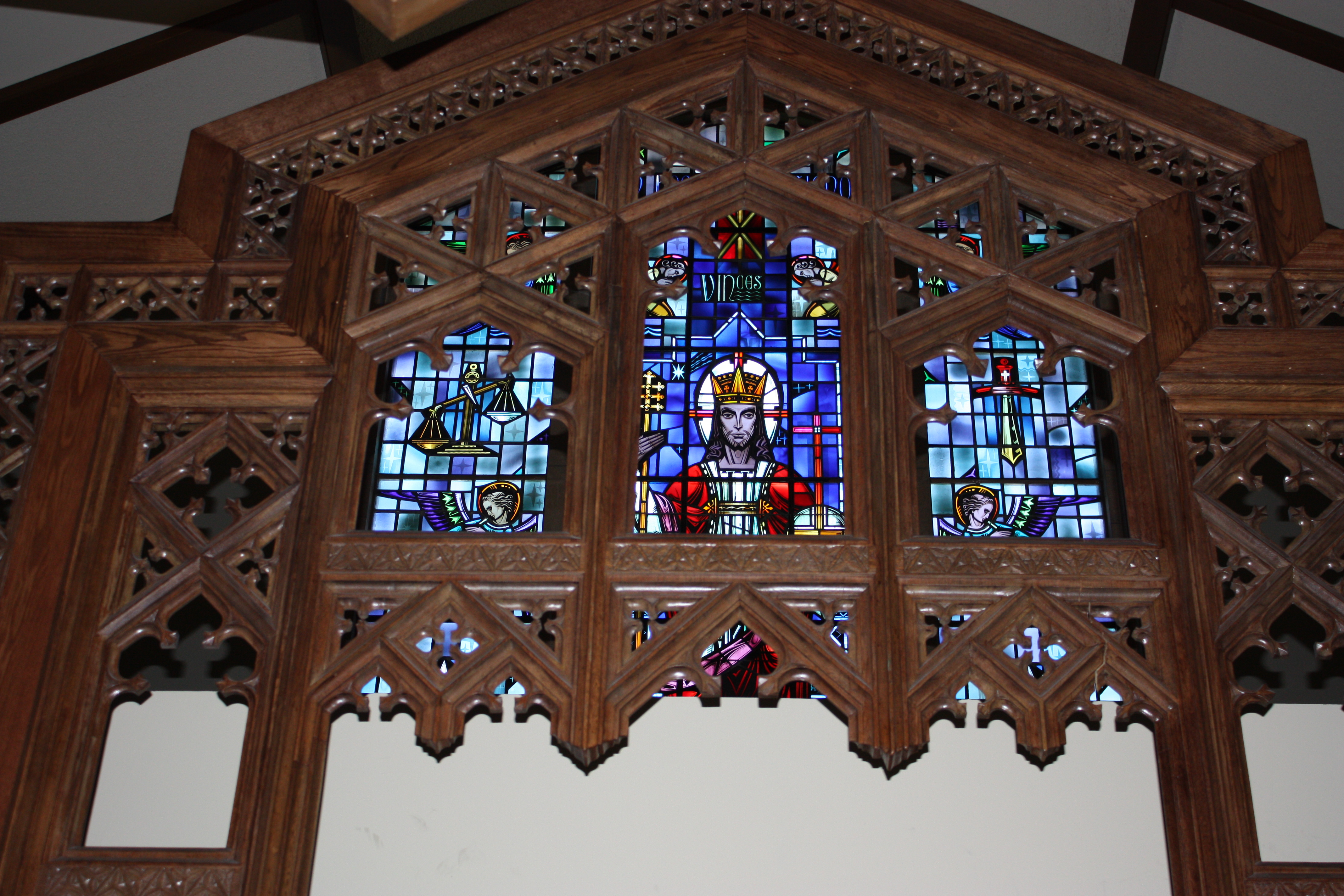 Large window with intricate wooden frames
