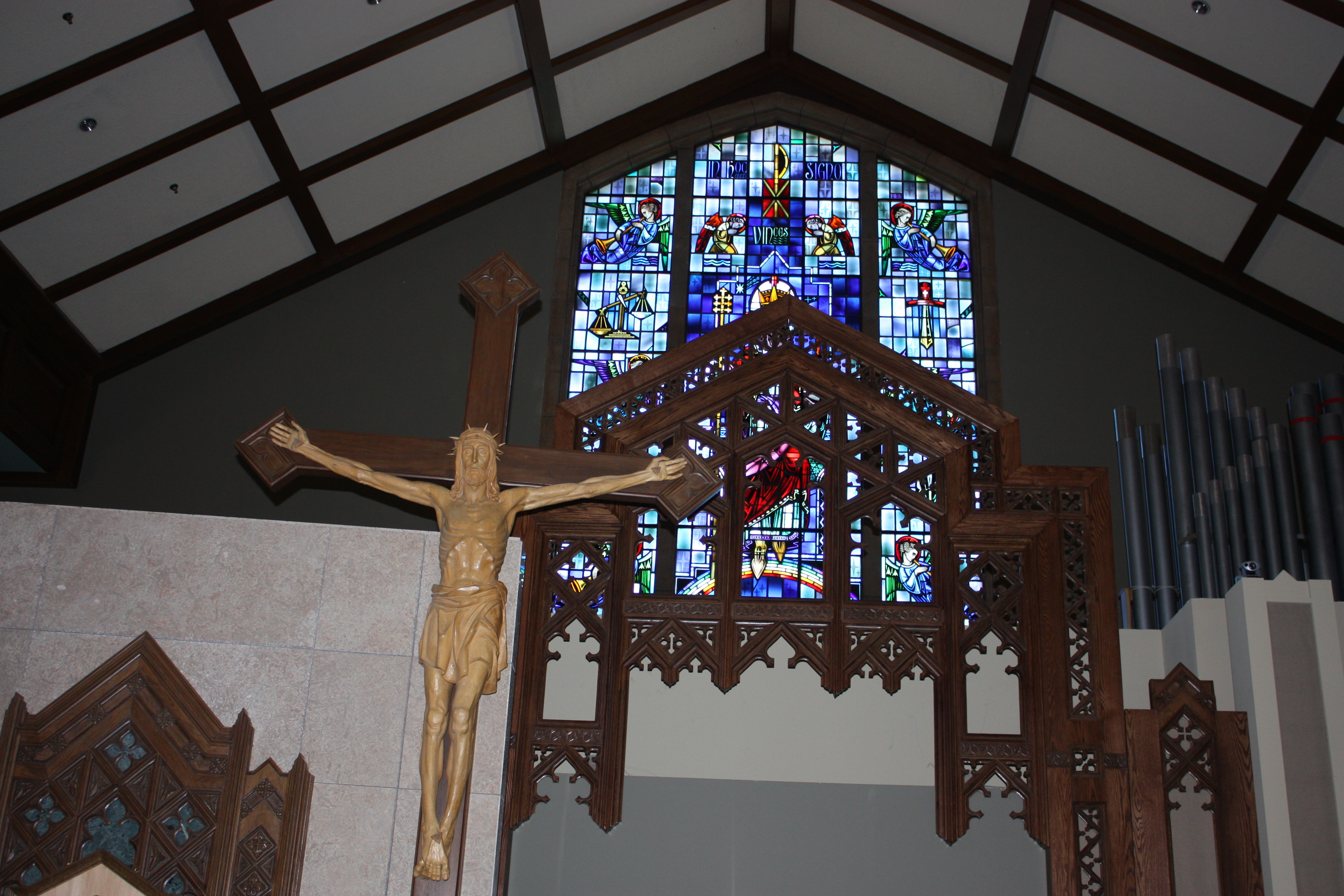 Distanced view of wooden window frame with Christ on cross in foreground