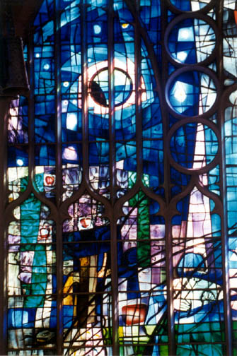 Large blue stained glass window in Alice S. Milar Chapel at Northwestern University