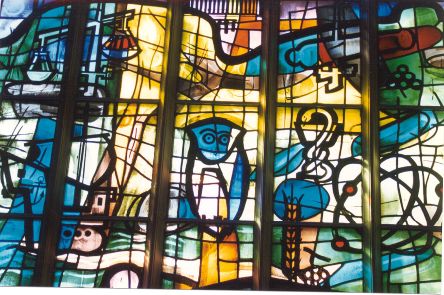 Stained glass window with owl in Alice S. Milar Chapel at Northwestern University