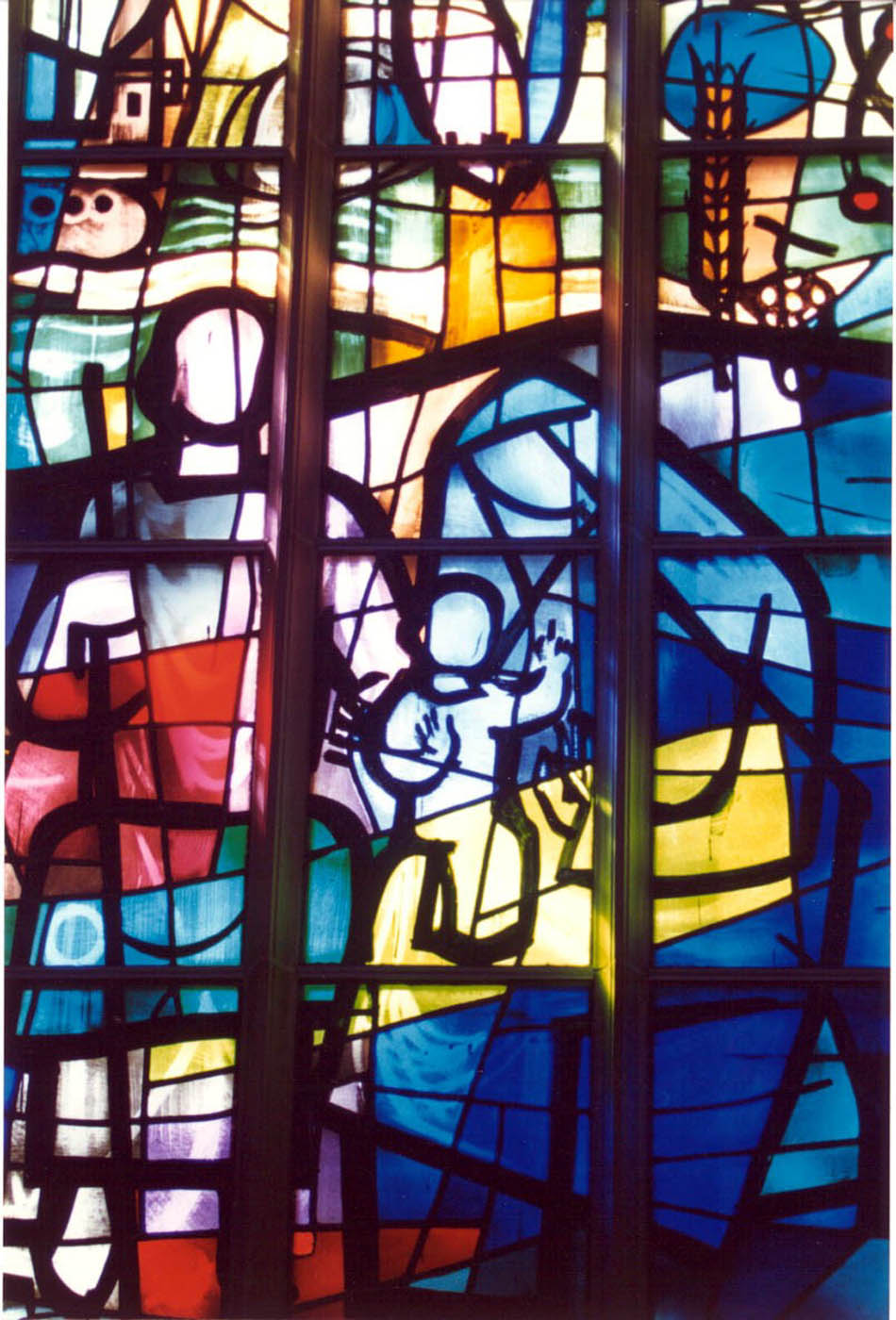 Blueish stained glass window with sitting Mary and Joseph in Alice S. Milar Chapel at Northwestern University