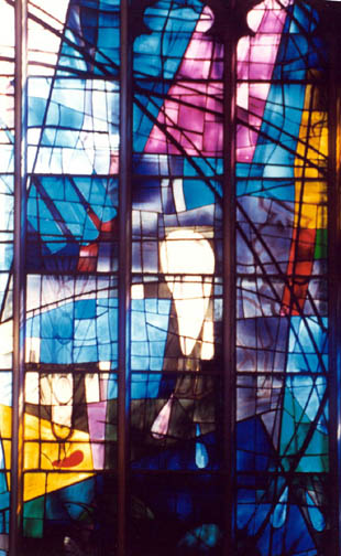 Large  stained glass window with blueish tint in Alice S. Milar Chapel at Northwestern University
